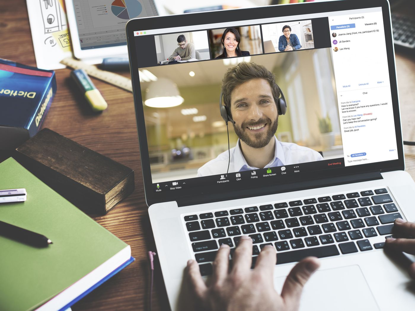 video conferencing meeting man on screen wearing headphone